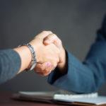 Negotiating business,Image businesswomen handshake,happy with wo