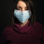 woman-in-purple-turtleneck-sweater-with-white-face-mask-4058870